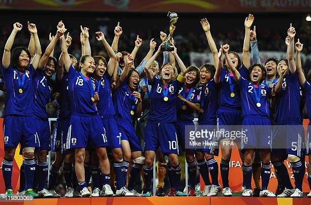 Captain Homare Sawa of Japan lifts the FIFA Women's World Cup and her team mates celebrate at the end of the FIFA Women's World Cup 2011 Final match...