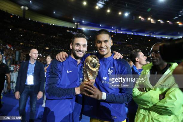 Captain Hugo LLoris and Alphonse Areola of France celebrate the FIFA World Cup with fan after the UEFA Nations League A group one match between...