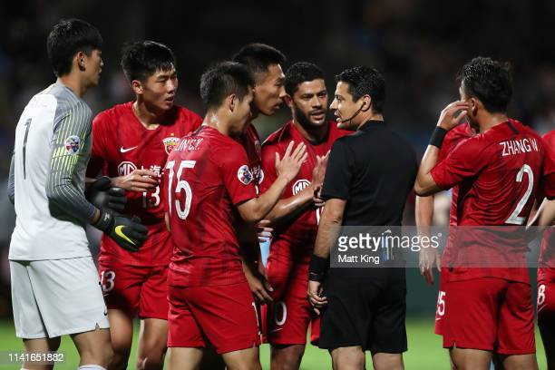 Captain Hulk of Shanghai SIPG and team mates argue with the referee after a penalty was given during the AFC Asian Champions League match between...