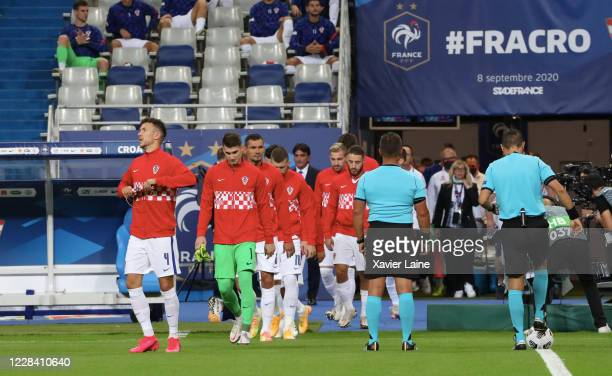 Captain Ivan Perisic of Croatia enters the field with his teammates during the UEFA Nations League group stage match between France and Croatia at...