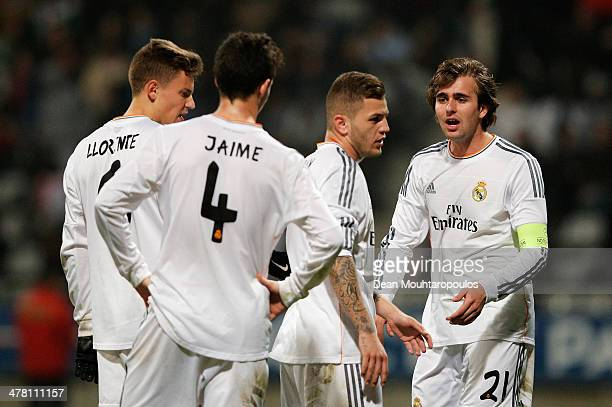 Captain Ivan Saez of Real Madrid speaks to Marcos Llorente Jaime Sanchez and Agoney Gonzalez during the UEFA Youth League Quarter Final match between...