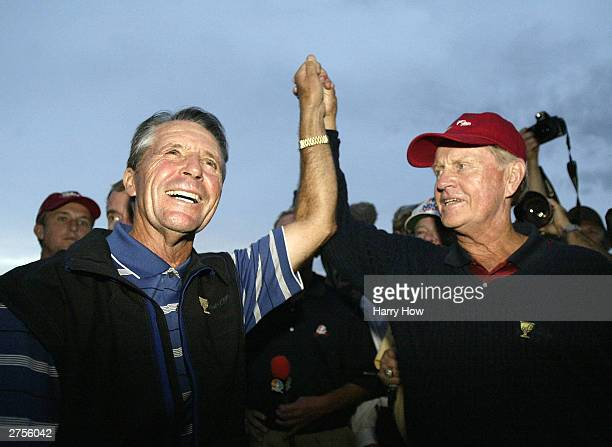 USA Captain Jack Nicklaus and International Team Captain of Gary Player of South Africa raise each others hands in ending the match in a 1717 draw...