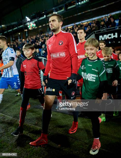 Captain Jakob Poulsen of FC Midtjylland leading his players on to the pitch prior to the Danish Alka Superliga match between FC Midtjylland and OB...