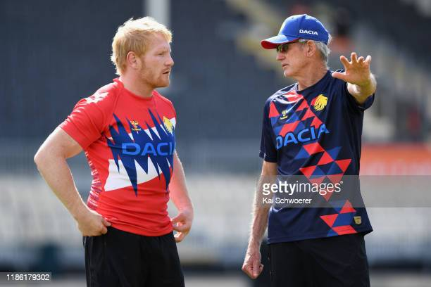 Captain James Graham and Head Coach Wayne Bennett look on during a Great Britain Rugby League Lions training session at Orangetheory Stadium on...