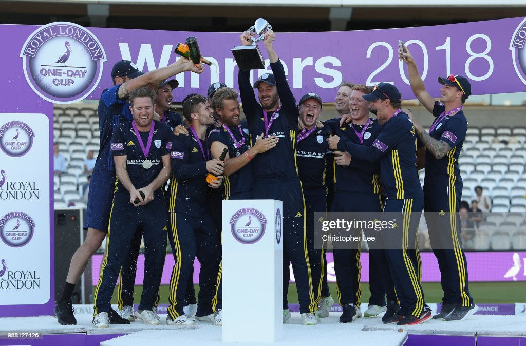 Captain James Vince of Hampshire lifts the Trophy as the team celebrate their victory during the Royal London One-Day Cup Final match between Kent and Hampshire at Lord's Cricket Ground on June 30, 2018 in London, England.