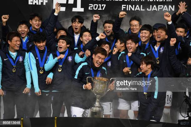 Captain Jang Hyunsoo of South Korea lifts the trophy as they celebrate the East Asian Champions at the award ceremony following their 41 victory in...