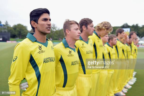Captain Jason Sangha of Australia and his team mates line up for their national anthems prior to the ICC U19 Cricket World Cup Semi Final match...