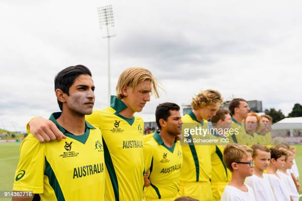 Captain Jason Sangha of Australia and his team mates line up for their national anthem prior to the ICC U19 Cricket World Cup Final match between...