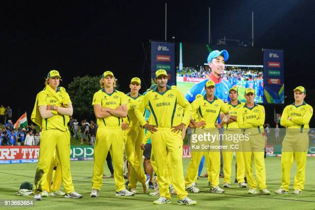 Captain Jason Sangha of Australia and his team mates look dejected after their loss in the ICC U19 Cricket World Cup Final match between Australia...