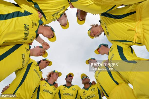Captain Jason Sangha of Australia speaks to his team mates prior to the ICC U19 Cricket World Cup match between Zimbabwe and Australia at Lincoln...