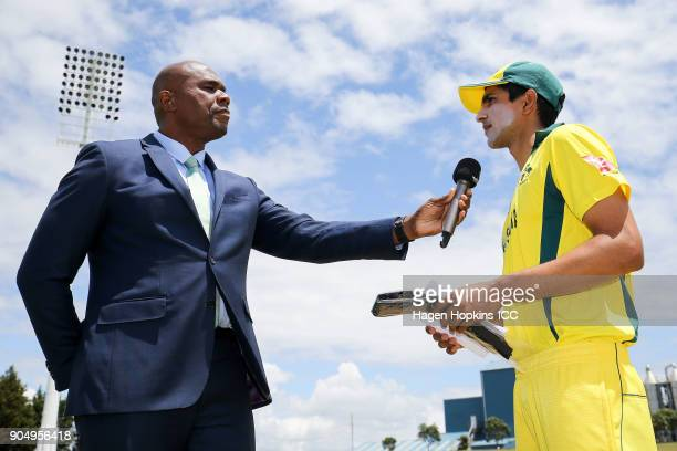 Captain Jason Sangha of Australia talks to presenter Ian Bishop during the ICC U19 Cricket World Cup match between India and Australia at Bay Oval on...