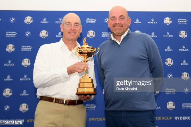 Captain Jim Furyk of the United States and captain Thomas Bjorn of Europe pose with the trophy as they attend a press conference ahead of the 42nd...