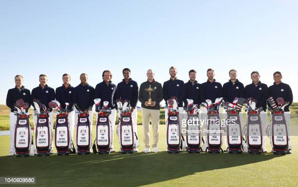 Captain Jim Furyk of the United States holds the Ryder Cup trophy as he poses with his team during a photocall ahead of the 2018 Ryder Cup at Le Golf...
