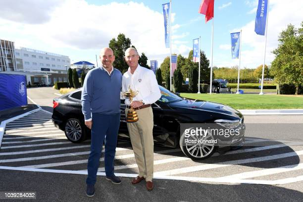 Captain Jim Furyk of the United States is greeted by captain Thomas Bjorn of Europe as he returns the trophy ahead of the 42nd Ryder Cup 2018 at Le...