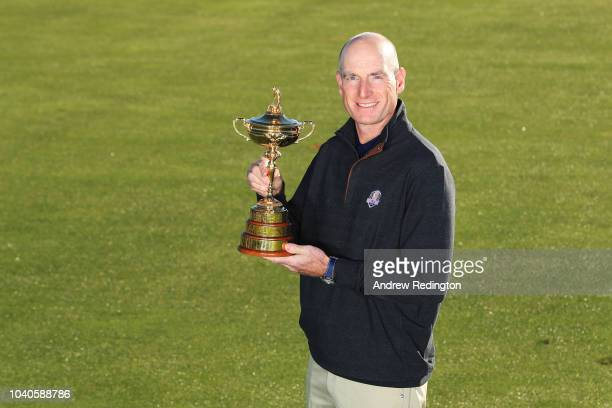 Captain Jim Furyk of the United States poses with the Ryder Cup during a photocall ahead of the 2018 Ryder Cup at Le Golf National on September 26...
