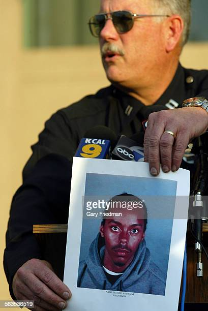 Captain Jim Miller of 77th LAPD holds a photo of Antwaine Butler a suspect in the shooting of Clyde Jackson age 14 who was shot outside Magee's...