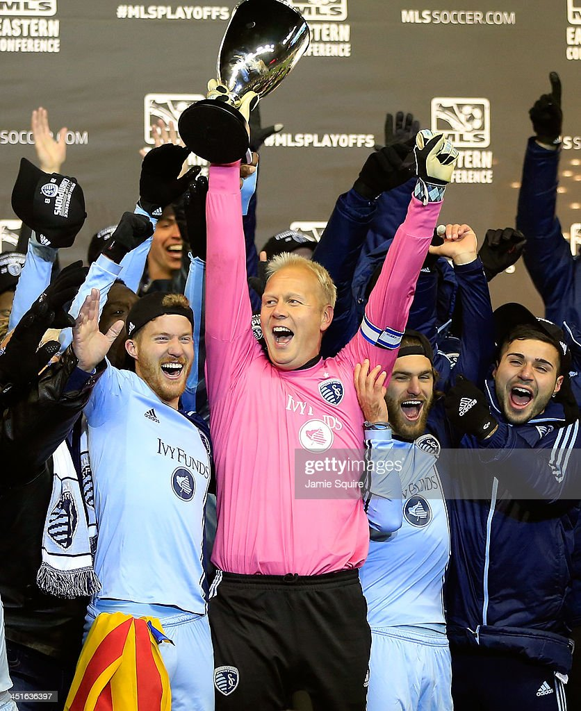 Captain Jimmy Nielsen #1 of the Sporting KC hoists the trophy with teammates after Sporting KC defeated the Houston Dynamo to win the Eastern Conference Championship at Sporting Park on November 23, 2013 in Kansas City, Kansas.
