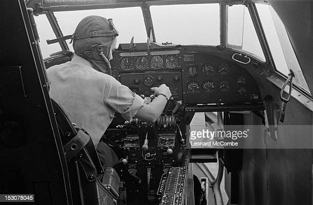 Captain Joan Hughes of the ATA prepares to start up a Lockheed Hudson bomber for an instructional flight September 1944 ATA pilots deliver newly...