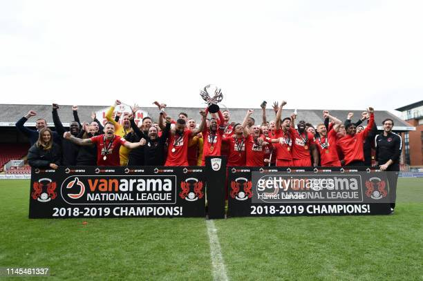 Captain Jobi McAnuff of Leyton Orient lifts the trophy as they win the title after the Vanarama National League match between Leyton Orient and...