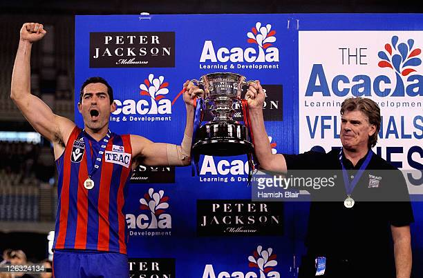 Captain John Baird and coach Gary Ayres of Port Melbourne with the trophy after the VFL Grand Final match between Port Melbourne and Williamstown at...