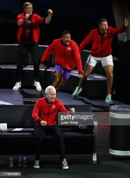 Captain John McEnroe, Nick Kyrgios and Jack Sock of Team World celebrate in the singles match between Dominic Thiem of Team Europe and Taylor Fritz...