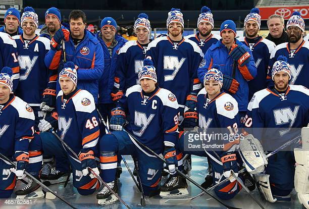 Captain John Tavares of the New York Islanders poses for a group photo with his teammates during the 2014 NHL Stadium Series practice session at...