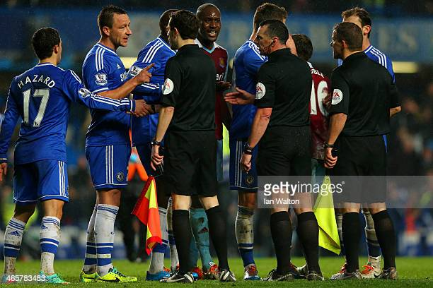 Captain John Terry has words with Referee Neil Swarbrick during the Barclays Premier League match between Chelsea and West Ham United at Stamford...