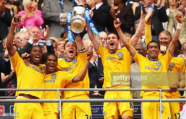 Captain John Terry of Chelsea lifts the trophy with Frank Lampard following victory during the FA Cup sponsored by EON Final match between Chelsea...