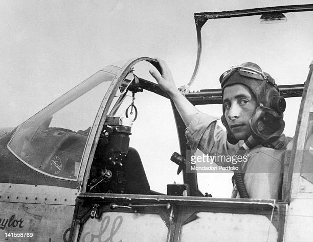 US captain John Voll sitting in his Mustang fighter plane back from an escort mission to bombers operating in southern Germany Italy November 1944