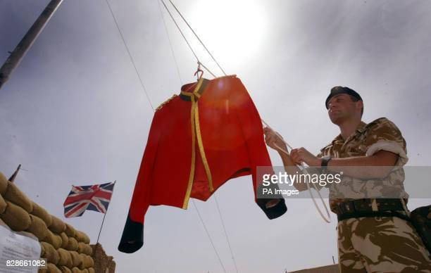 Captain John Westward of the Worcestershire and Sherwood Foresters hosits a red jacket over their camp in Kuwait On the 6th April 1812 as the English...