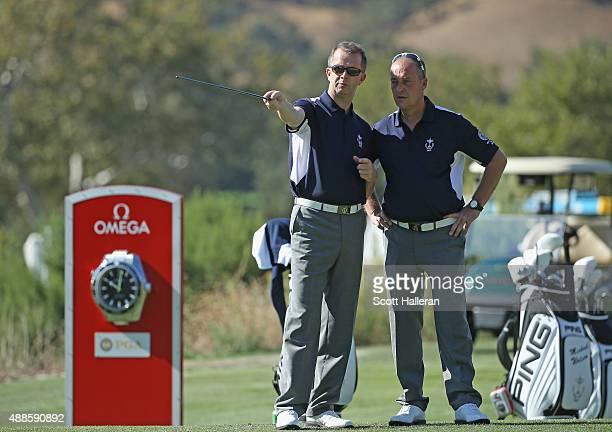 Captain Jon Bevan of the Great Britain Ireland team chats with vice captain Martyn Thompson on the practice ground prior to the start of the 27th PGA...