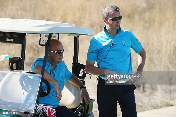 Captain Jon Bevan of the Great Britain Ireland team chats with vice captain Martyn Thompson during the Friday Foursomes matches at the 27th PGA Cup...
