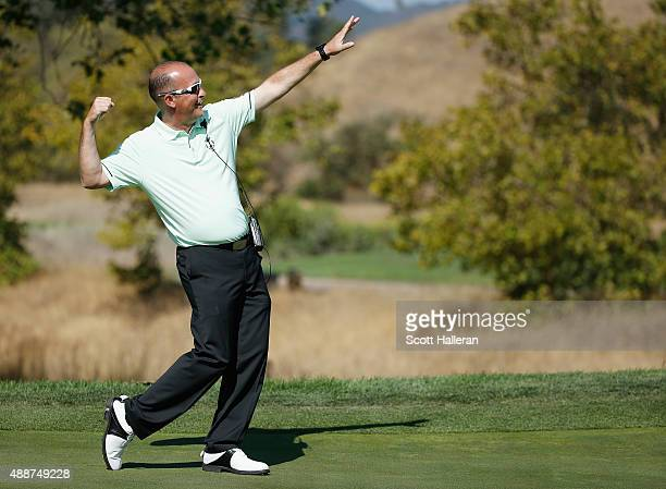 Captain Jon Bevan of the Great Britain Ireland team strikes a Usain Bolt pose during a practice session prior to the start of the 27th PGA Cup at...
