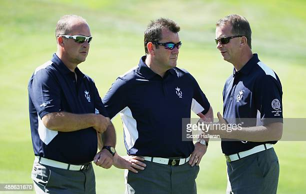 Captain Jon Bevan of the Great Britain Ireland team works alongside his vice captains Albert Mackenzie and Martyn Thompson during a practice session...