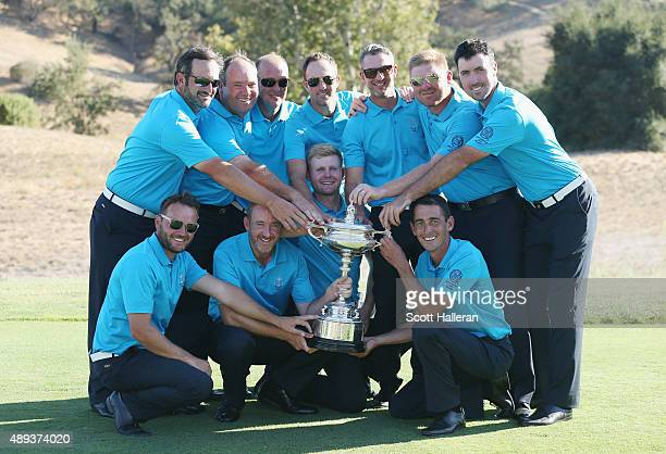 Captain Jon Bevan poses with his Great Britain Ireland team after they defeated the United States team 13 1/2 to 12 1/2 at the 27th PGA Cup at...