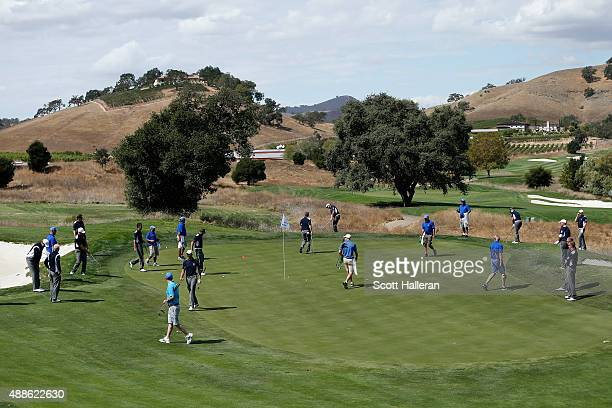 Captain Jon Bevan works with his entire Great Britain Ireland team on a green during a practice session prior to the start of the 27th PGA Cup at...