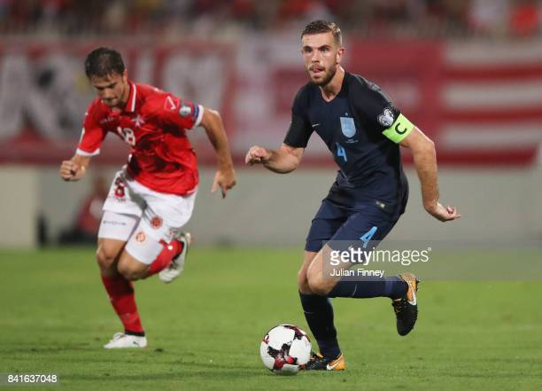 Captain Jordan Henderson of England runs with the ball during the FIFA 2018 World Cup Qualifier between Malta and England at Ta'Qali National Stadium...