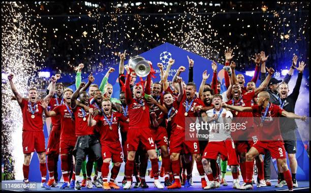 Captain Jorddan Henderson of Liverpool FC lifts the trophy after winning the UEFA Champions League final. During the UEFA Champions League final...