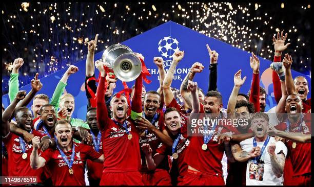 Captain Jorddan Henderson of Liverpool FC lifts the trophy after winning the UEFA Champions League final during the UEFA Champions League final match...