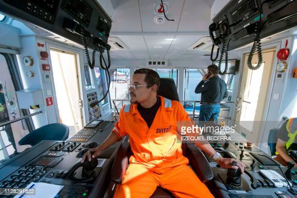 Captain Jorge Cedeno handles a tugboat during the inauguration of the APM Containers Terminal at the port of Moin in Limon Costa Rica on February 28...