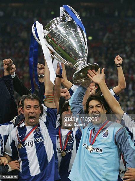 Captain Jorge Costa and goalkeeper Vitor Baia of FC Porto lift the Champions League trophy during the UEFA Champions League Final match between AS...