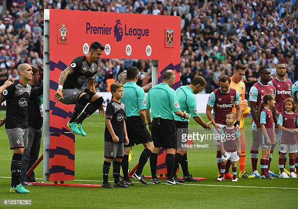 Captain Jose Fonte of Southampton jumps prior to the Premier League match between West Ham United and Southampton at London Stadium on September 25...