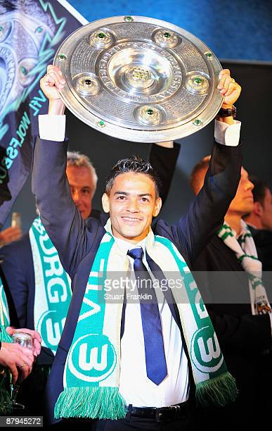 Captain Josue of Wolfsburg celebrates with the League trophy at the rathaus after winning the German championship after their Bundesliga match...