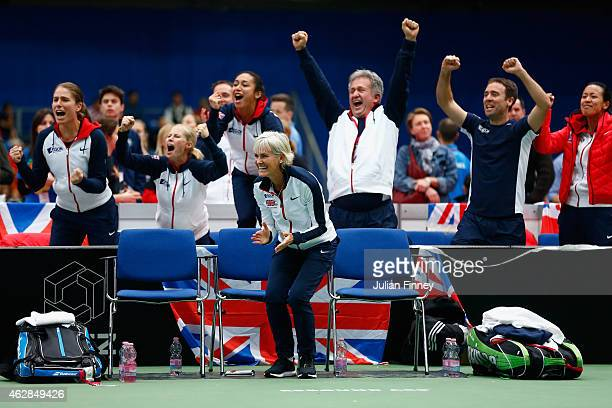 Captain Judy Murray leads the celebrations as Johanna Konta Heather Watson Louis Cayer Iain Bates Anne Keothavong show their support in the doubles...