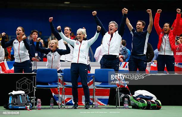 Captain Judy Murray leads the celebrations as Johanna Konta, Louis Cayer, Iain Bates, Anne Keothavong show their support in the doubles match between...