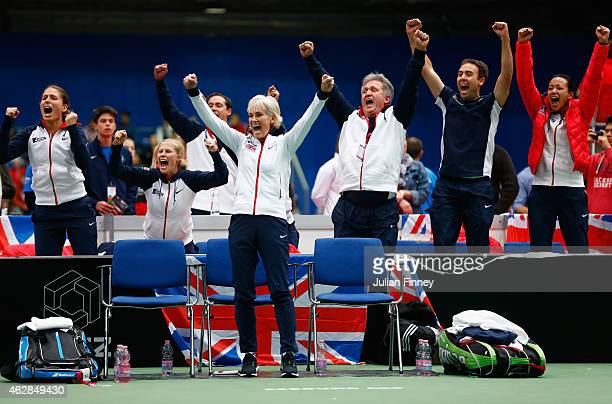 Captain Judy Murray leads the celebrations as Johanna Konta Louis Cayer Iain Bates Anne Keothavong show their support in the doubles match between...