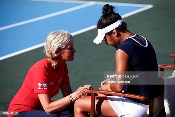 Captain Judy Murray talks with Heather Watson of Great Britain after her loss against Alison van Uytvanck of Belgium during the tie between Belgium...