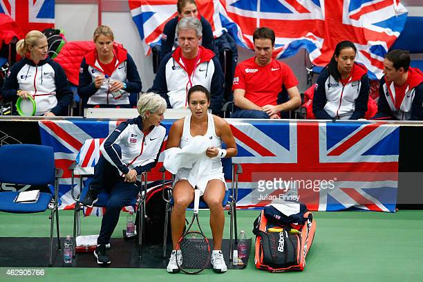 Captain Judy Murray talks with Heather Watson of Great Britain in her match against Victoria Azarenka of Belarus during day four of the Fed...