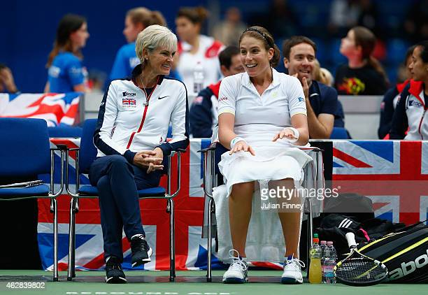 Captain Judy Murray talks with Johanna Konta of Great Britain in her match against Lesia Tsurenko of Ukraine during day three of the Fed Cup/Africa...