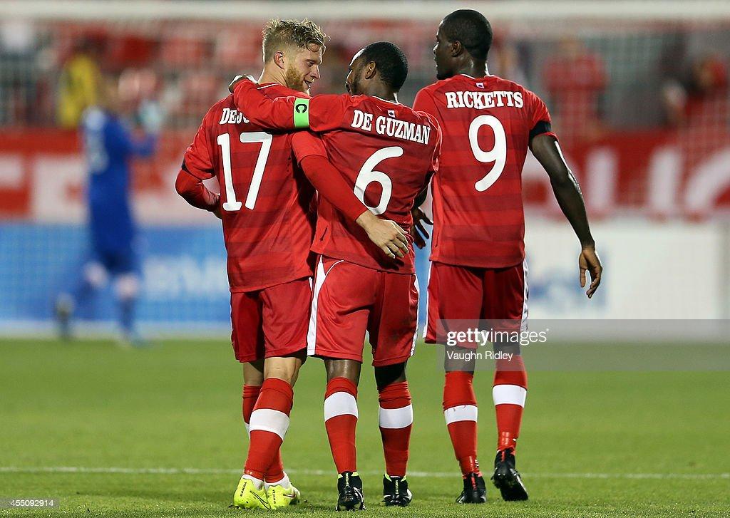 Captain Julian De Guzman of Canada congratulates goalscorer Marcel De Jong during the International Friendly match between Canada and Jamaica at BMO Field on September 09, 2014 in Toronto, Ontario, Canada.